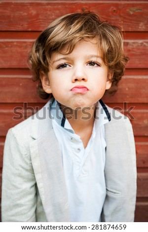 portrait of an angry little boy - stock photo