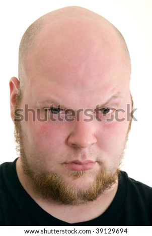 Portrait of an angry looking Caucasian man with a beard