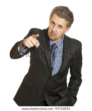 Portrait of an angry middle aged businessman in suit pointing at you isolated over white background - stock photo