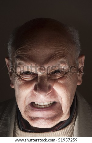 Portrait of an angry senior man - stock photo