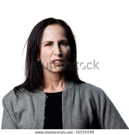Portrait of an angry woman, isolated studio image - stock photo