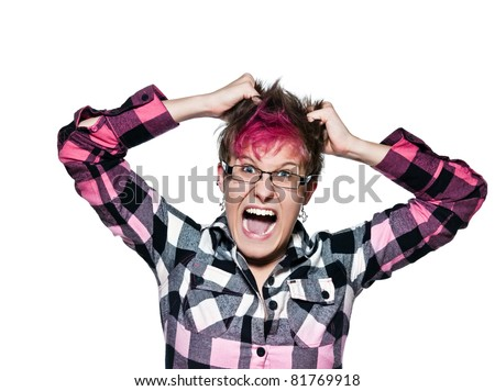 Portrait of an angry woman screams and pulls her hair in frustration in studio on white isolated background - stock photo