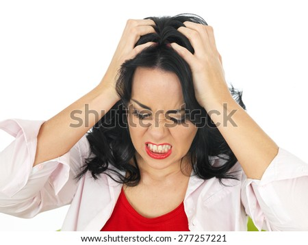 Portrait of an Angry Young Attractive Hispanic Woman in Her Twenties Pulling Her Hair in Rage - stock photo