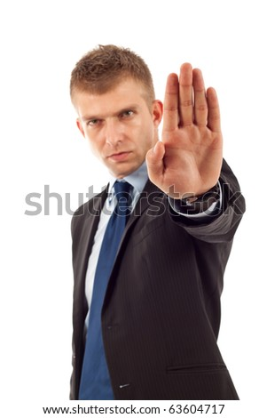 Portrait of an angry young male entrepreneur showing stop sign against white background