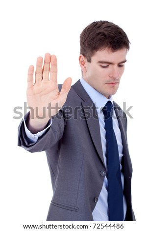 Portrait of an angry young male entrepreneur showing stop sign against white background - stock photo