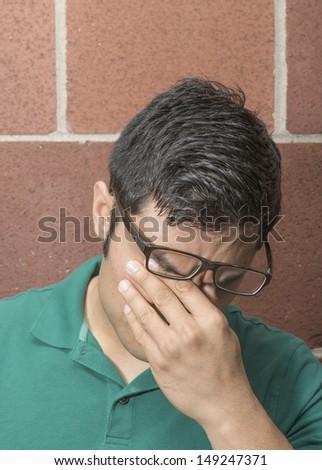 Portrait of an anxious man - stock photo