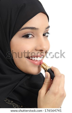 Portrait of an arab saudi emirates woman painting her lips with a lipstick isolated on a white background              - stock photo