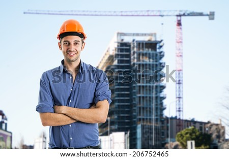 Portrait of an architect in front of a construction site - stock photo