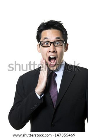 Portrait of an Asian business man looking suprised. Isolated on a white background. - stock photo