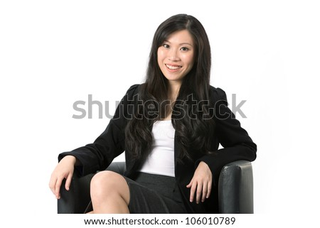 Portrait of an Asian Business woman sitting on a chair. Isolated on white background. - stock photo