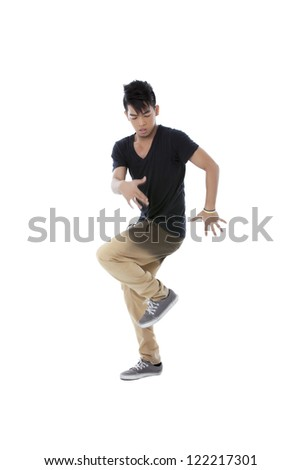 Portrait of an Asian dancer doing his dance move against white background - stock photo