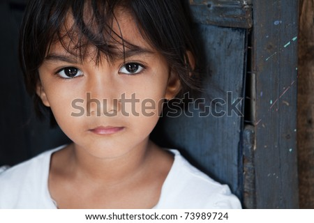 Portrait of an Asian girl against wall in natural light - Manila, Philippines - stock photo