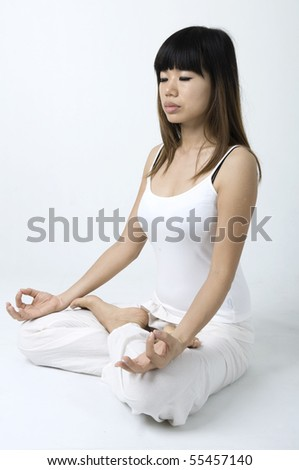 portrait of an asian girl performing yoga in a studio