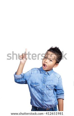 Portrait of an asian kid 7 year old  with an expression when he gets an idea or solution - stock photo