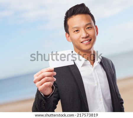 portrait of an asian man holding a white card