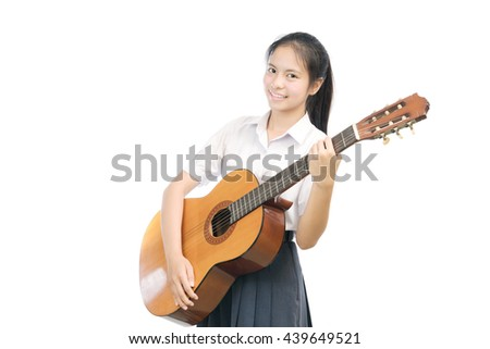 portrait of an Asian student holding Guitar on white background - stock photo