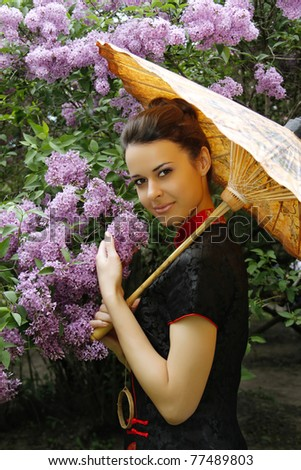 portrait of an asian style woman in lilac