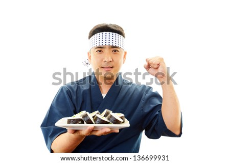 Portrait of an Asian waiter - stock photo