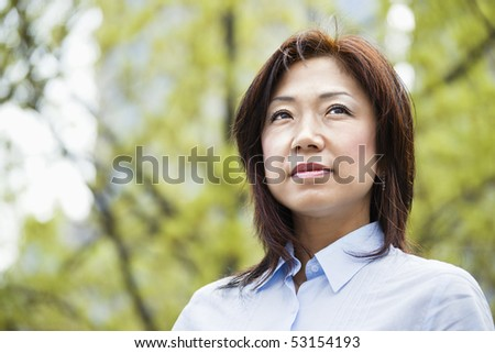 Portrait of an Asian woman outdoors. - stock photo