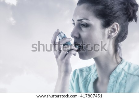 Portrait of an asthmatic woman against beige background - stock photo