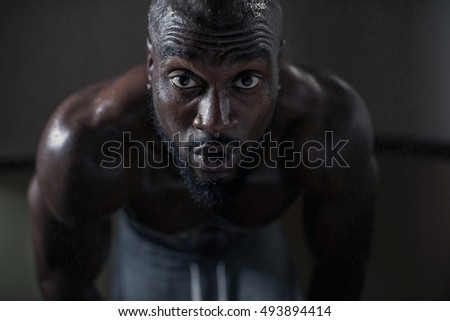 Portrait Of An Athlete During Intense Workout African American Muscular Man Dripping Sweat