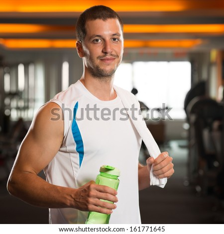 Portrait of an athlete with bottle of water