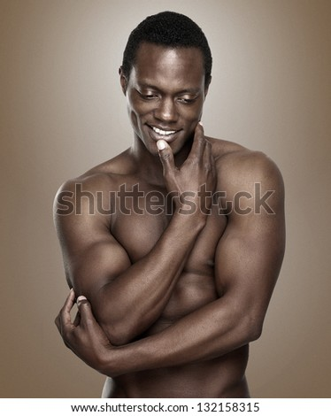 Portrait of an athletic african american man smiling - stock photo