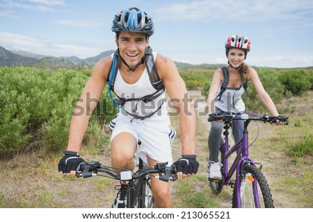 Portrait of an athletic couple mountain biking