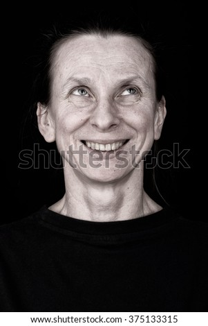 Portrait of an attractive adult woman looking up and smiling