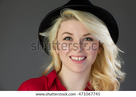 Portrait of an attractive and happy blonde woman