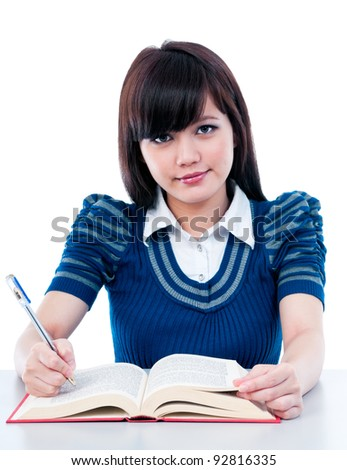 Portrait of an attractive Asian female student studying.
