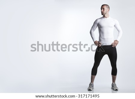 Portrait of an attractive athlete in running dress - stock photo