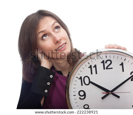 Portrait of an attractive beautiful pretty cute young brown haired caucasian thoughtful woman (lady, girl) who is keeping the clock in her hand that shows ten past ten. Isolated on white background.  - stock photo