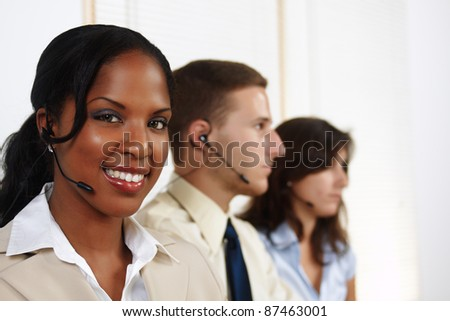 Portrait of an attractive black woman telephone operator. - stock photo