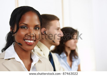 Portrait of an attractive black woman telephone operator.