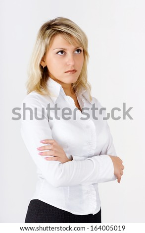 Portrait of an attractive blonde girl standing - stock photo