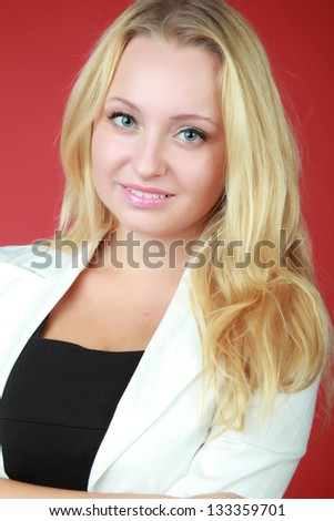 Portrait of an attractive blonde woman in a business suit - stock photo
