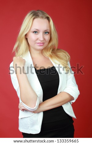 Portrait of an attractive blonde woman in a business suit on Business and Finance - stock photo