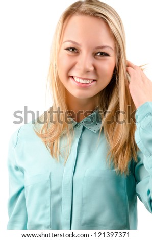 Portrait of an attractive blonde woman smiling at the camera with her hand to her hair isolated on white - stock photo