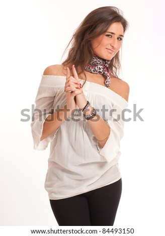 Portrait of an attractive brunette in a joking gesture - stock photo