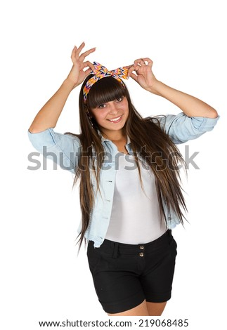 Portrait of an attractive brunette with a bow on her head isolated on white background - stock photo