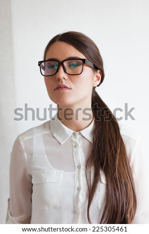 Portrait of an attractive brunette with glasses