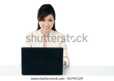 Portrait of an attractive businesswoman using laptop with copy space over white background. - stock photo