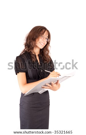 Portrait of an attractive businesswoman writing in a file