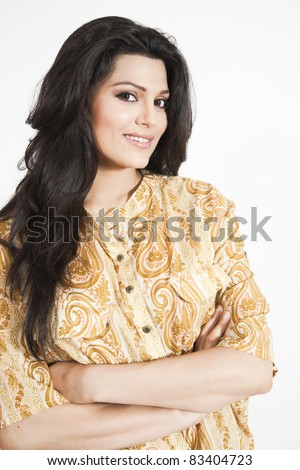 portrait of an attractive charming girl wearing paisley design shirt - stock photo