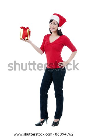 Portrait of an attractive Christmas woman holding a gift box against white background - stock photo