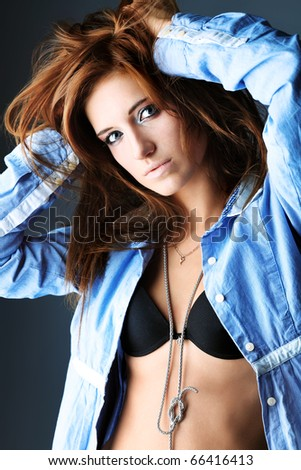 Portrait of an attractive  fashionable woman. Studio shot.