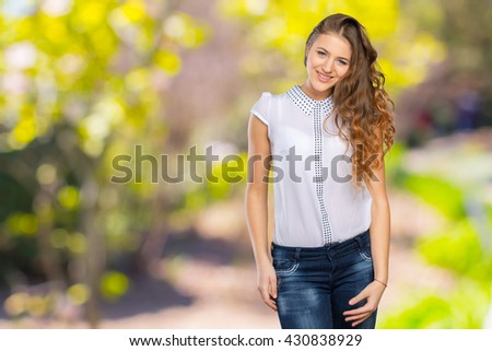 Portrait of an attractive fashionable young brunette woman. - stock photo