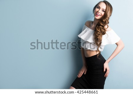 Portrait of an attractive fashionable young brunette woman. Beauty, fashion, hair and makeup. - stock photo