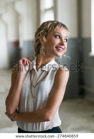 Portrait of an attractive fashionable young woman - stock photo